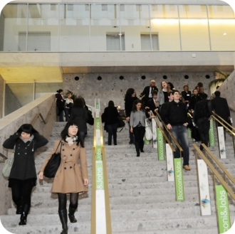 Students walking down staircase at career event