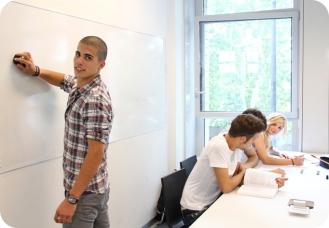 Student erasing whiteboard