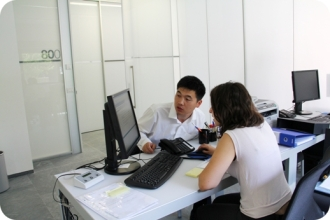 Student in office with computer