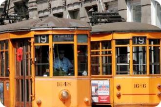 Two trams in traffic