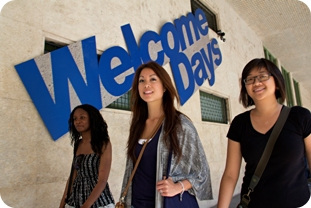Students walking in front of Welcome Days sign