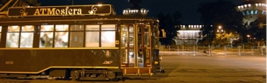 Restaurant tram at night in front of castle