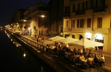 Night photo of canal and outside cafés