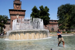 Young man in fountain in front of Castello Sforzesco