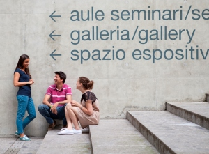 Students chatting in front of bilingual signs